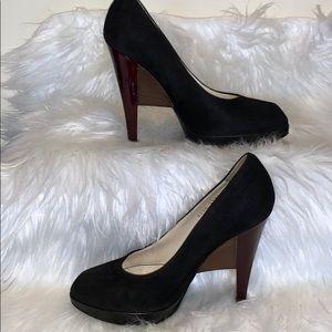 YSL black suede pumps with architectural heel